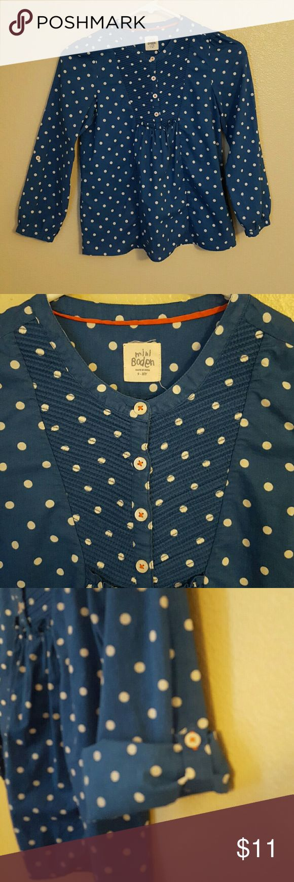 Mini Boden girls 9-10y blue white polkadot blouse This Mini Boden blue with white polka dot blouse is size 9/10. It is a beautiful almost teal blue. Option to cut the sleeves and button them. For buttons in front with a smocked panel and pleated detail. Mini Boden Shirts & Tops Blouses