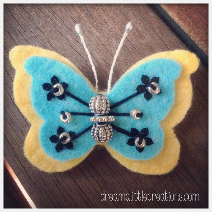 Handmade by dream a little. Felt and bead butterfly brooch. 6cm by 5cm with a brooch back.