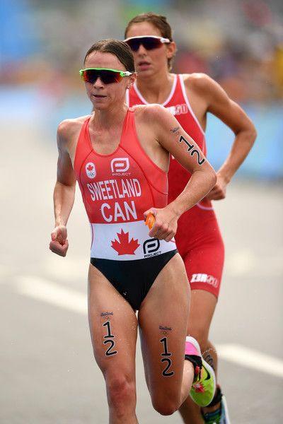 Kirsten Sweetland (12) of Canada and Sara Vilic (31) of Austria run during the Women's Triathlon on Day 15 of the Rio 2016 Olympic Games at Fort Copacabana on August 20, 2016 in Rio de Janeiro, Brazil.