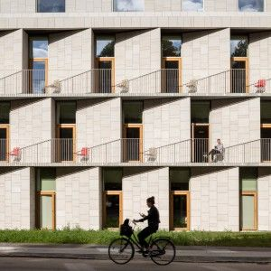 3XN+completes+Copenhagen+hospital+building+featuring+slanted+stone+walls