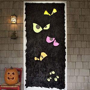 Entrance doors are for wreaths (I believe) but I have patio doors I could do this on.  I'd use fun foam instead of paper, tho, for the eyes. And, definitely some glow-y things.  *wicked smile*