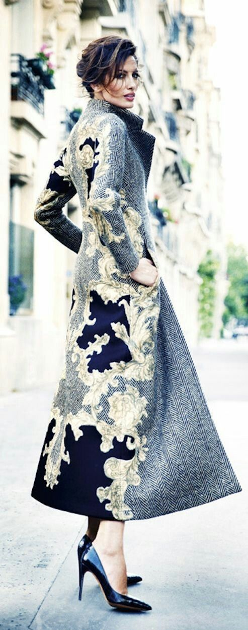 The original post on this pix talked about the heels, but I just love the tapestry or paisley design on the coat - its just so different and divinely different!
