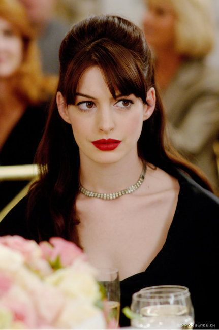 Anne Hathaway in The Devil Wears Prada, after transformation.