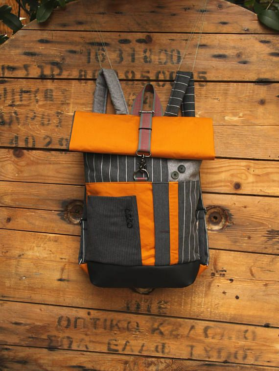 Gray & yellow upcycled roll top rucksack using parts from men's suits, roll top with a hidden pocket on the back for your valuables, by 'eating the goober'