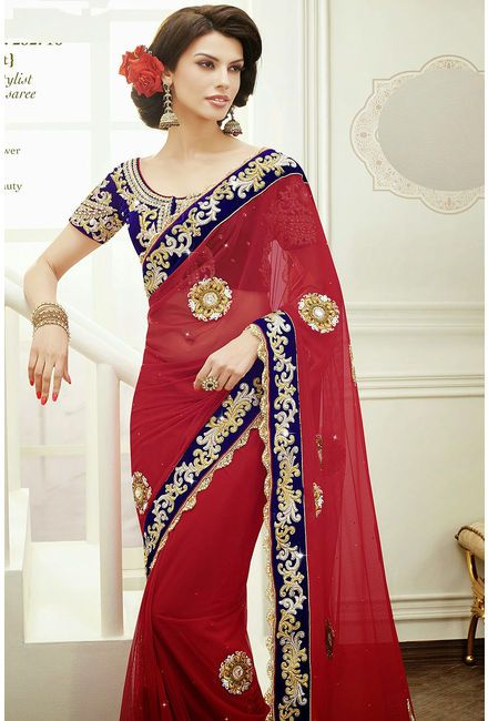 Red Net Saree Comes With A Contrast Royal Blue Velvet Blouse
