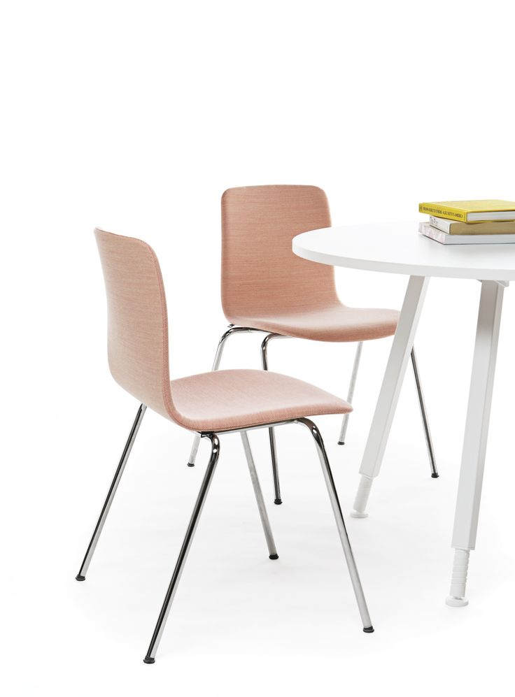 Sola chair with a four leg base has several upholstery options, including a non-upholstered version. Design Antti Kotilainen.