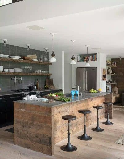 Reclaimed timber and concrete worktop - better with a polished concrete floor. great timber great shelves