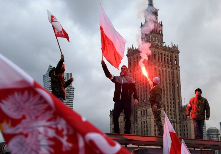 Around 60,000 people marched in Warsaw on Independence Day, some chanting anti-Semitic, anti-Muslim and anti-gay slogans.