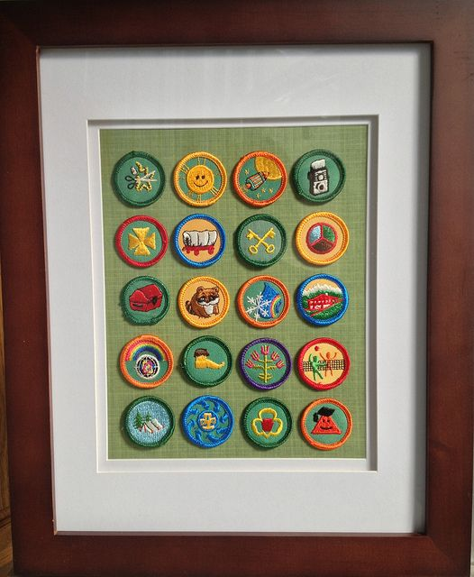 Vintage Girl Scout badges mounted in a gallery frame.  Or if I do it with my girl's badges now, they'll be vintage some day. ;)