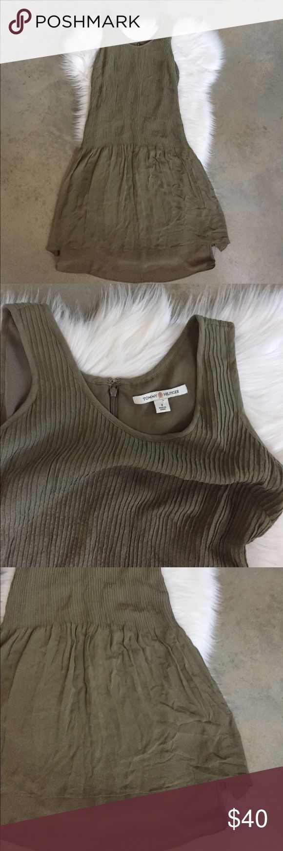 """Tommy Hilfiger Pleated Drop Waist 100% Silk Dress Gorgeous army green sleeveless silk dress from Tommy Hilfiger. Size 2, in very good used condition. Dress features pleated top, drop waist, fully lined, hidden center back zipper and is made of 100% silk.   Length - 39.5"""" Chest - 16.5""""  Please feel free to ask any questions. No trades, offers welcome. Tommy Hilfiger Dresses Mini"""