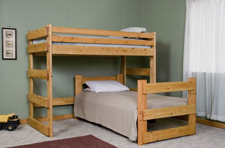 Cool space-saving L-shaped twin bunk beds for 3 persons. They're of wooden materials with a pretty natural finish. Beds have across slatted headboards, ...