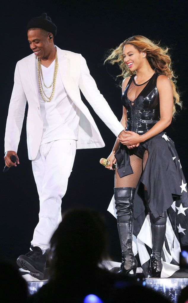 JAY Z & BEYONCÉ What marriage troubles? The musical power couple are all smiles during their On the Run concert in Seattle.