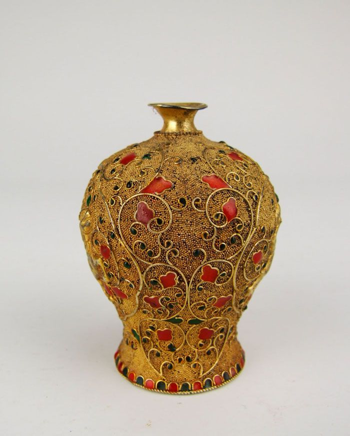 Qing Dynasty Qianlong imperial ware gilt silver Vase with beast pattern. Qianlong was the sixth emperor of the Manchu-led Qing Dynasty, and the fourth Qing emperor to rule over China proper. The fourth son of the Yongzheng Emperor, Qianlong reigned from 11 October 1735 to 8 February 1796. #Qing_Dynasty