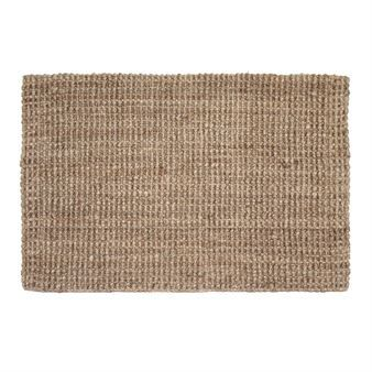 A handwoven door mat in jute from Dixie is a rug that will make your hall extra stylish and trendy. The door mat is durable and hand-woven and comes in several sizes and colors.