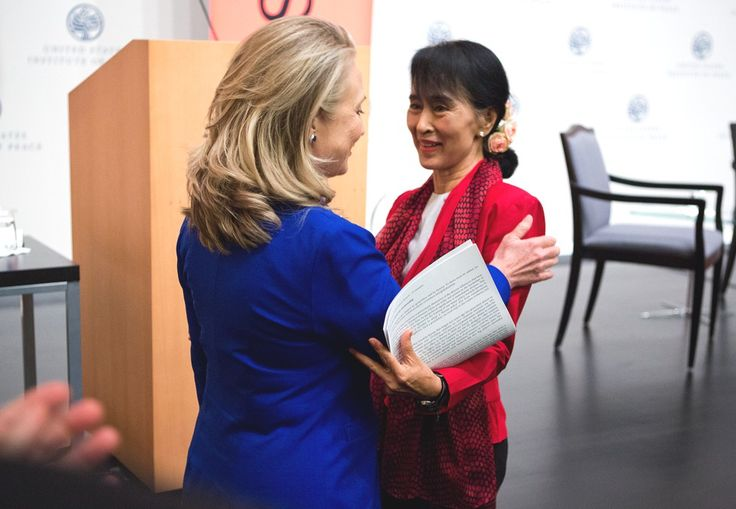 Myanmar parliamentarian Aung San Suu Kyi (R) and U.S. Secretary of State Hillary Clinton embrace during an Asia Society event at the United States Institute of Peace in Washington, D.C., on September 18, 2012. (Asia Society/Joshua Roberts)