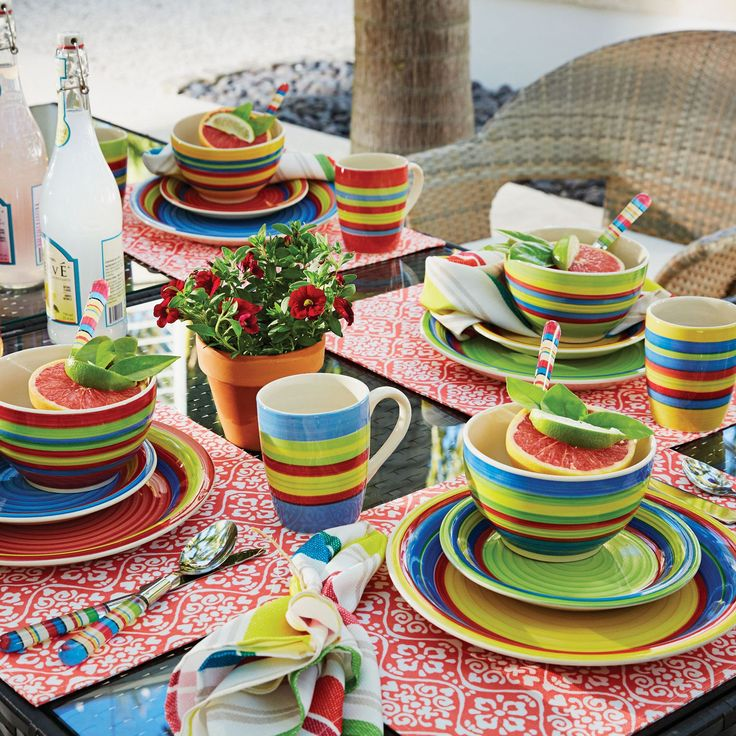 Our 16-pc. hand-painted striped stoneware dinnerware lets color live in style that's unique and creative. This matching set with green, blue, red, and yellow stripes will liven up your kitchen countertop and dinning table with a touch of southwestern flair.   • hand-painted stoneware • microwave and dishwasher safe   Set Includes: 4 10¼'' dinner plates, 4 7¼'' salad/dessert plates, 4 20-oz. bowls, 4 10-oz. ...