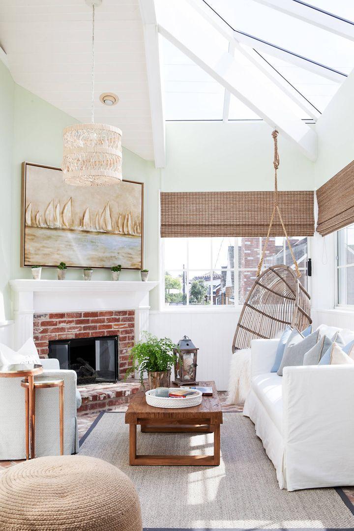 coastal sunroom with hanging chair