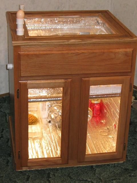 DIY Cabinet Incubator - I see cabinets come up on Craigslist for free all the time. I think I might pick up the next one I see and build this for when we get low on chickens, lol.