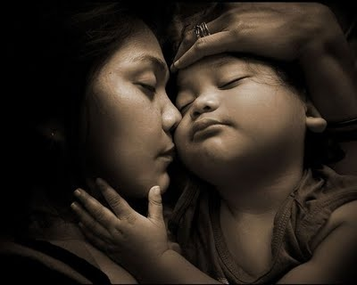 The love of a mama and child.....sleeping safely and soundly in each others arms.