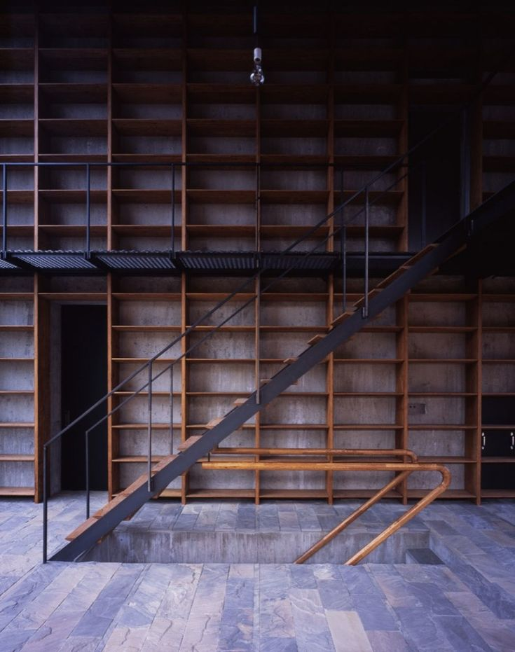 Stairs (previous pinners comment). I would have to say forget the stairs look at all the bookshelves!!!