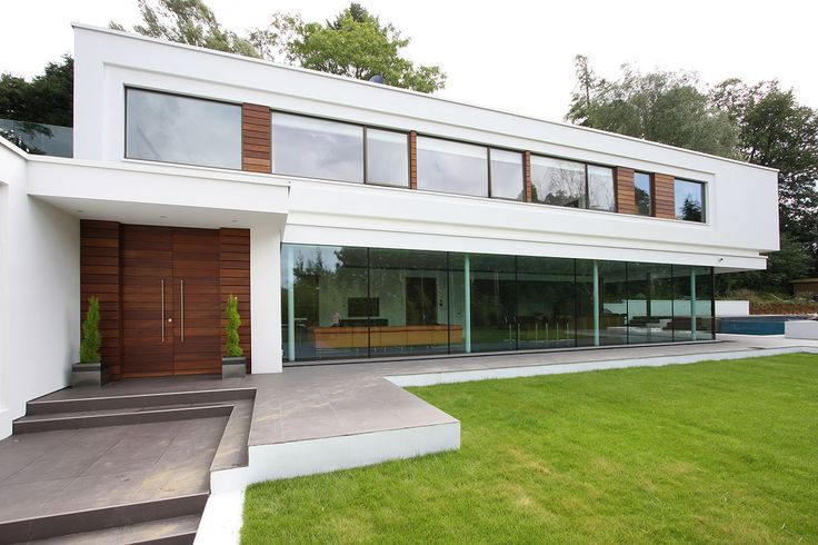Slim framed aluminium windows to a contemporary new build house in Surrey