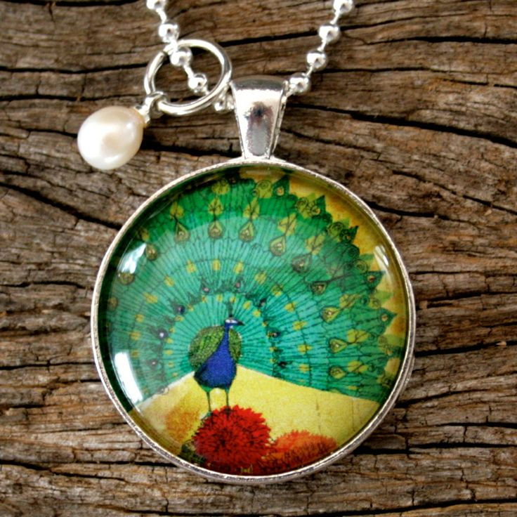 This colorful Peacock pendant with pearl charm necklace by Nest of Pambula now stocked at Ari Liv Jewellery online, in silver