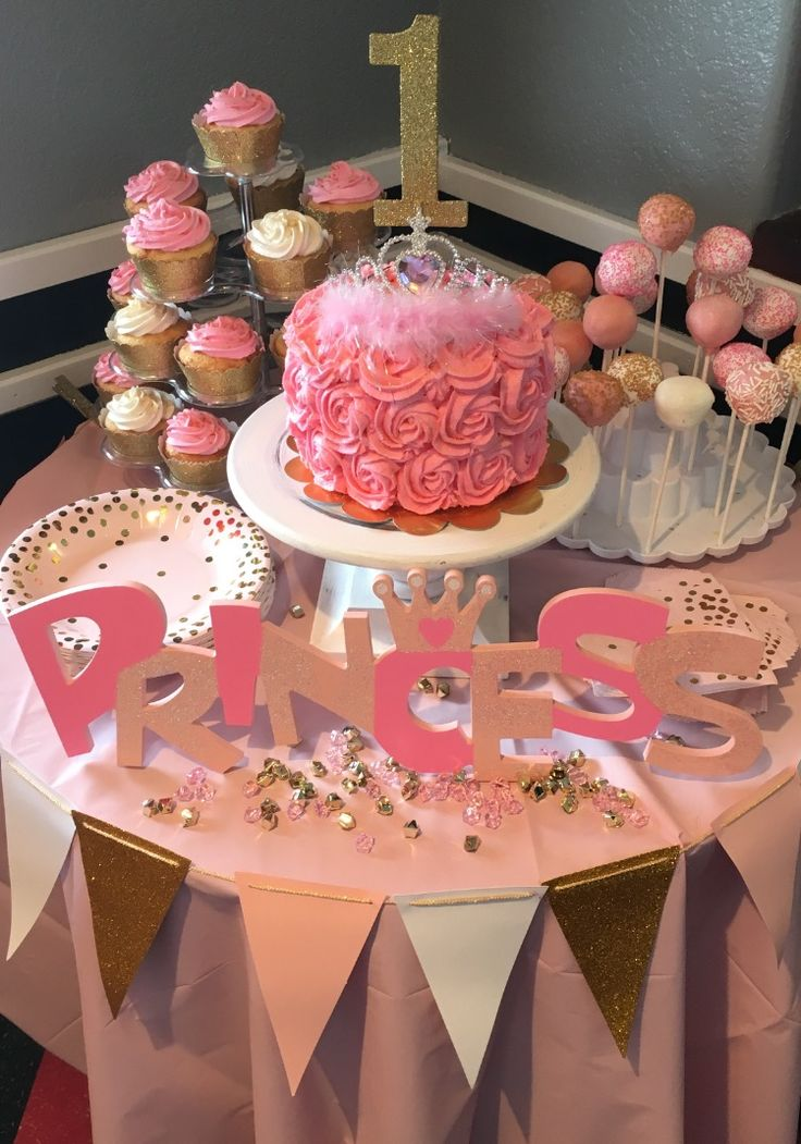 1st First Birthday Pink and Gold Princess Party, pink and gold Cake pops, pink rosette princess smash cake, pink and white cupcakes. 1st first birthday ideas, 1st first girl birthday. Click to go to blog page to get recipes, how to DIY ideas and more...
