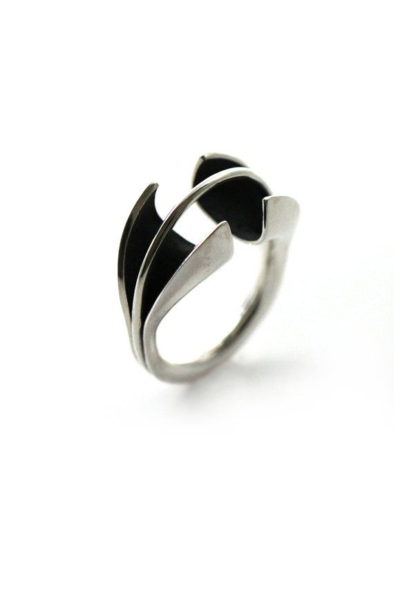 Adjustable modern ring made of 925 Starling Silver and Brass. The ring is constructed of two separate rings. The first, is the silver casing of a