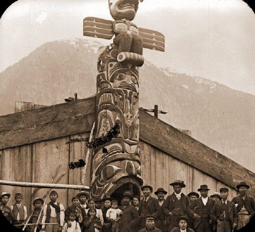 Monuments of Ancient Cedar. an 1895 photo of Nuxalk longhouse with cedar totem pole.