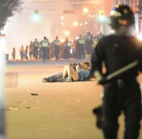 Making out during a riot - talk about being the only two people in the world, wrapped up in a moment