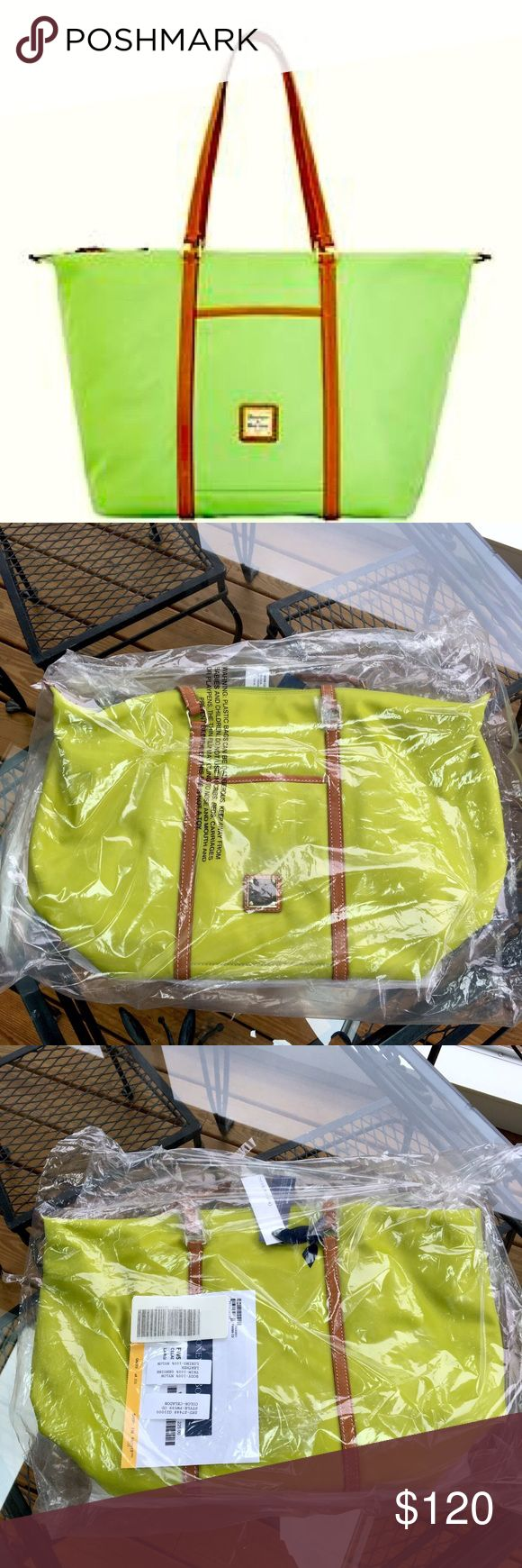 Large Green Tote bag This is a gorgeous, brand new with original packaging Dooney & Bourke tote bag! It is very fashionable but big enough to store anything! Dooney & Bourke Bags Totes