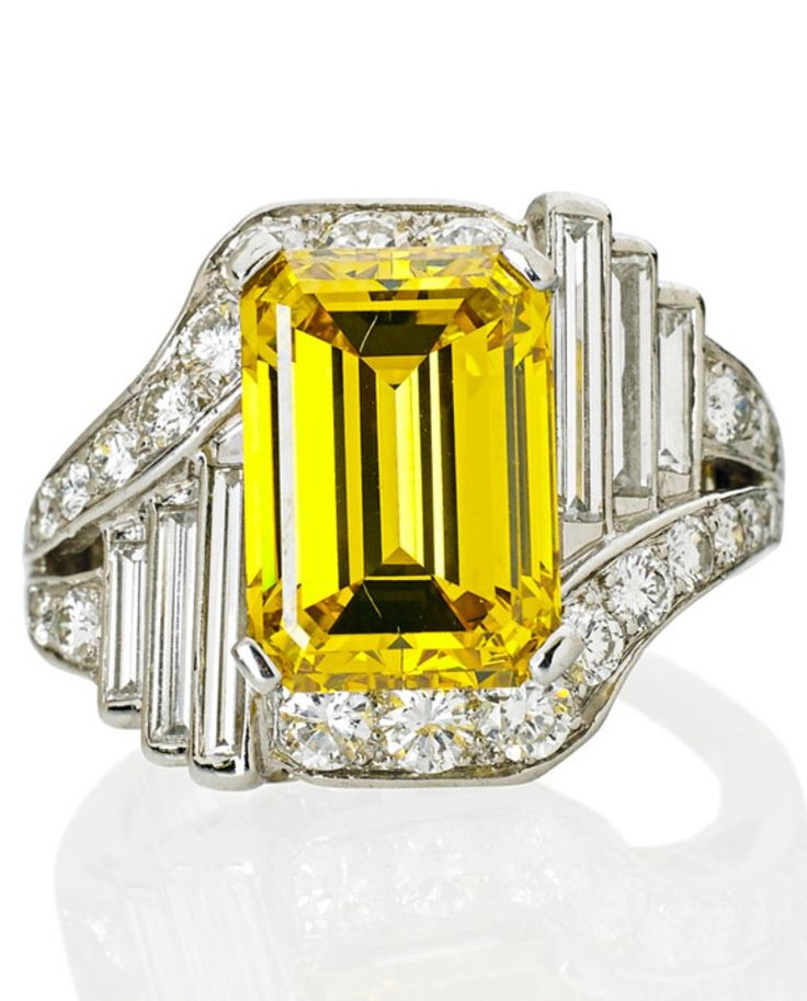 AN ART DECO YELLOW & WHITE DIAMOND PLATINUM RING, CIRCA 1935. A step cut intense yellow diamond, 7.69 carats, bypassed by round brilliant cut diamonds and an asymmetrical mirror of graduated baguette cut diamonds. Stamped 10% Irid. platinum. #ArtDeco #ring