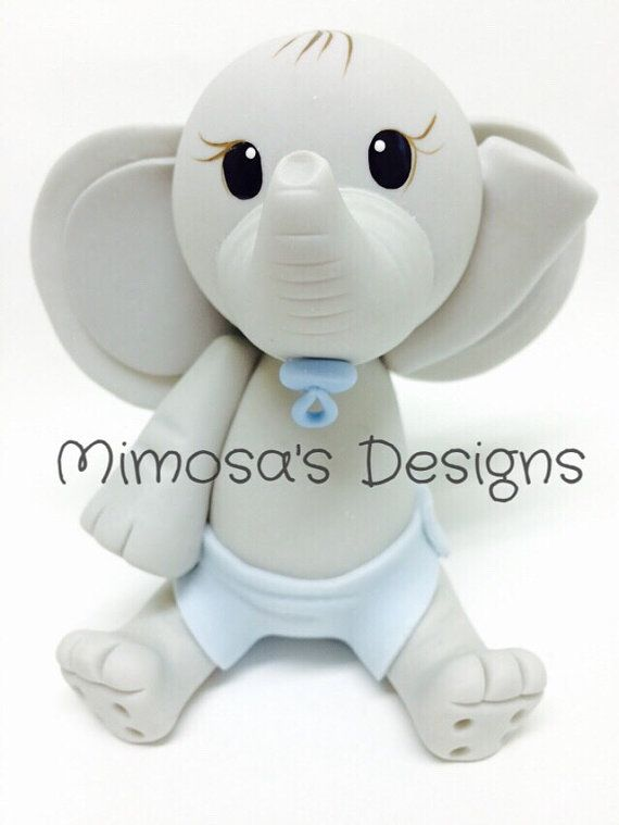 Lovely hand made piece of art. Baby Elephant cake topper. Measures 5 inches. Very light. Ready to ship. Features Adorable Baby Elephant with