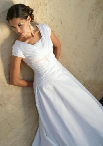 Romantic A-line deep V-neck short cap sleeves chapel train lace, & its a modest wedding dress