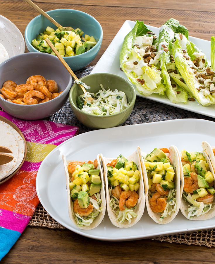 Here, we're making Mexican-inspired soft tacos filled with seasoned shrimp, creamy slaw and an herbaceously sweet pineapple-avocado salsa.