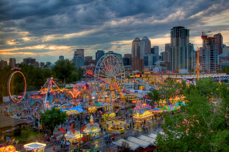 The midway of the Calgary Stampede with the Calgary skyline in the background