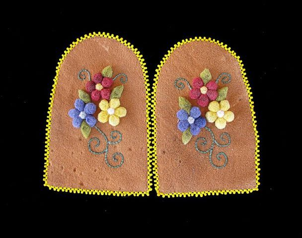 """Caribou embroidered moccasin vamps in honor for """"Walking with our Sisters"""" event bringing awareness to the missing and exploited women and children By Bonnie Bowen"""