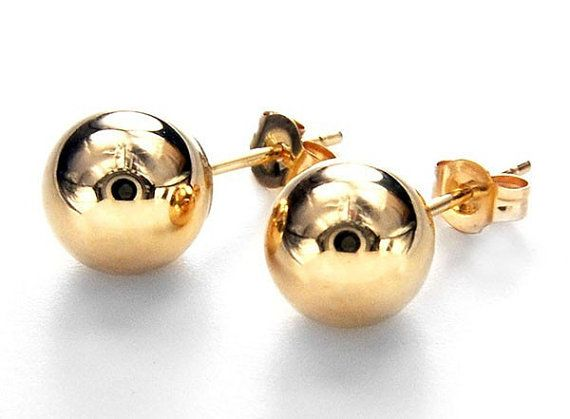 14K Solid Yellow Gold SHINY 8mm BALL Stud Earrings offered by HalfPennyBoutique, $94.99 https://www.etsy.com/listing/160090699/14k-solid-yellow-gold-shiny-8mm-ball Pair of 8mm BALL earrings is perfect for a child, great starter earrings for ear piercing or a second pair of earrings next to your hoops or dangles. Men or bikers like a single post in the left ear? Stamped 14K