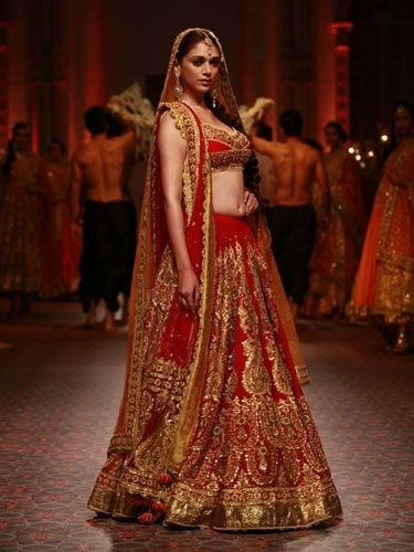 aditi walks the ramp in a bridal lehenga