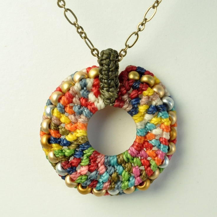 Use a plastic ring in the center, and crochet around with nylon cord. Do the last round with beads.