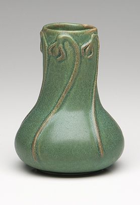 Pewabic Pottery Snowdrop Vase    Founded in 1903 at the height of the Arts and Crafts movement, Pewabic Pottery produced nationally renowned vessels, tiles and architectural ornamentation. Now over 100 years old, Pewabic Pottery is still creating ceramics that are accessible to art lover.