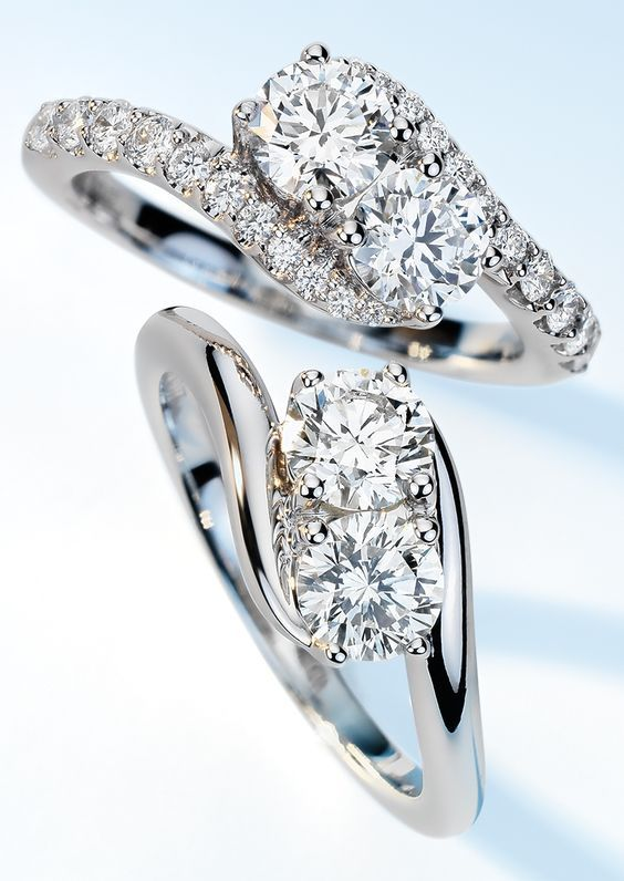 This 1 carat diamond ring expresses the harmony of union with an elegant intertwined two-stone diamond design and brilliant pavé-set diamond accents.