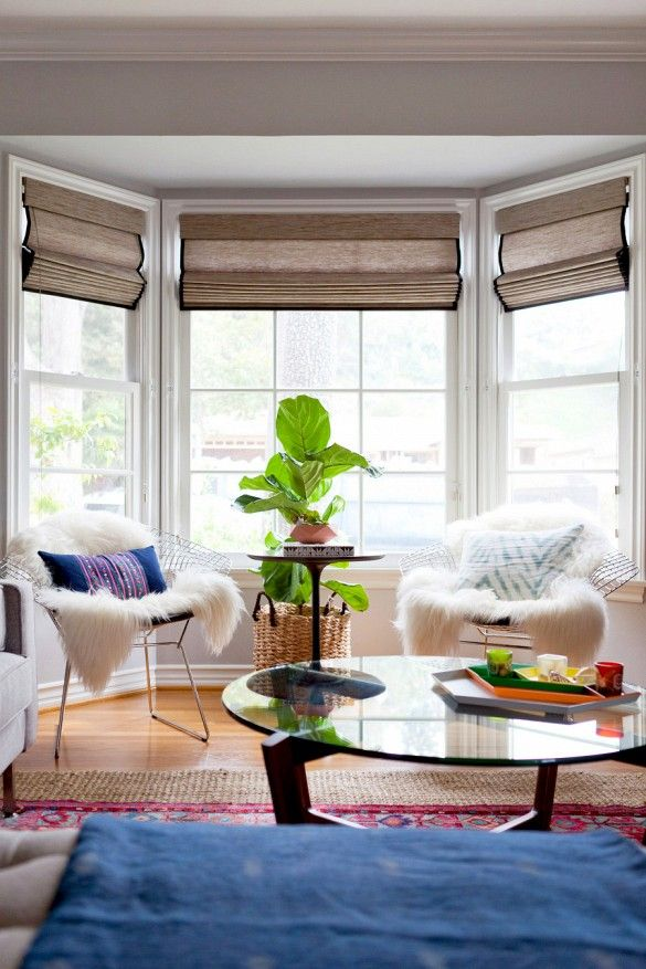 Tour an Eclectic and Colorful LA Bungalow via @domainehome Bay window seating at its best.  Fur throws over chairs add a cozy and textural touch.  Warm and inviting.