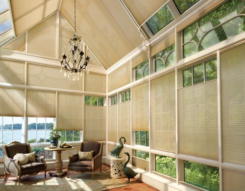 Increase the energy efficiency of your sun room with custom shades! The shades here are so versatile and provide an array of style and exposure options.