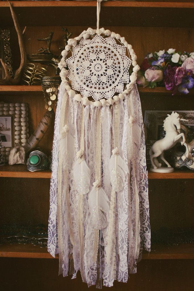 Crochet a doily you adore and transform it into a dream catcher.Dress the train in colors that compliment both the Dream Catcher and your decor.Lovely..