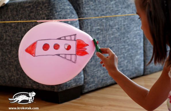 This looks fun!  Rocket balloon on string using a straw.