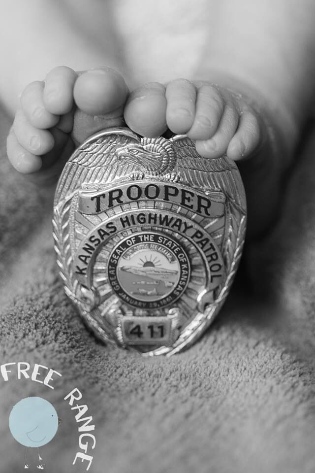 Newborn photography State trooper badge with baby toes Kansas newborn photography  Freerangephoto.net
