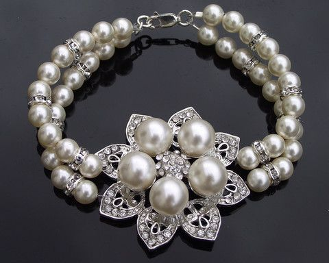 Floral Pearl Bracelet: €72/$98.  http://www.julesbridaljewellery.com/collections/wedding-bracelets/products/flower-style-pearl-bridal-bracelet-alyson-l