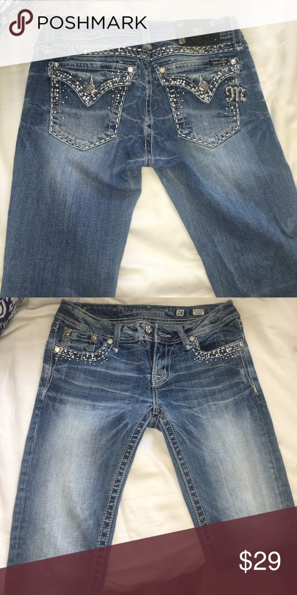 Miss me jeans Gently worn. Beautiful rhinestone jeans. One button is off on the top backside of the jeans, hardly noticeable. The jeans were altered at the buckle store to fit my height of 5'2. Miss Me Jeans Skinny
