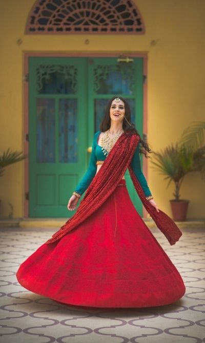 modern bridal lehenga, red threadwork lehenga, red bridal lehenga, red sequinned dupatta, shimmery dupatta, layered jewellery, full sleeved blouse, sweetheart neckline blouse, threadwork, contrast blouse, jewel toned , emerald green blouse, lehenga, win